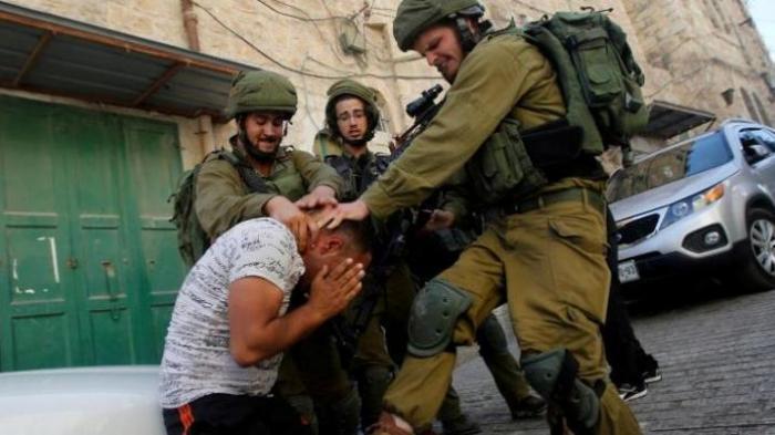 1516283340tentara-israel-tertangkap-kamera-pukuli-seorang-pria-palestina_20160922_224118.jpg